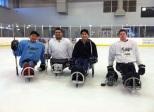 With the local ice sled hockey team